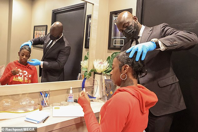 Examination: Dr. Obeng examined Tessica's head before applying the mixture of chemicals that dissolved the glue