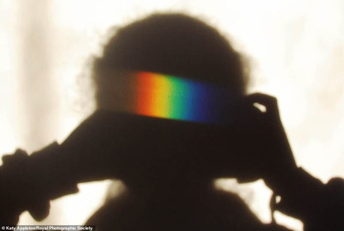 Katy Appleton, 12, won the Young Science Photographer of the Year in the general category which shows a spectrum of light cast on a wall after passing through a prism. It also overlaps with Katy's own shadow. 'I was very excited and surprised when I found out that my image had won,' Katy said