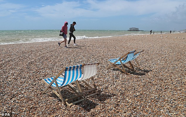 Quiet beach: Trade body Visit Britain estimated that the UK received 96 per cent fewer inbound visitors between April and June last year against the same time in 2019