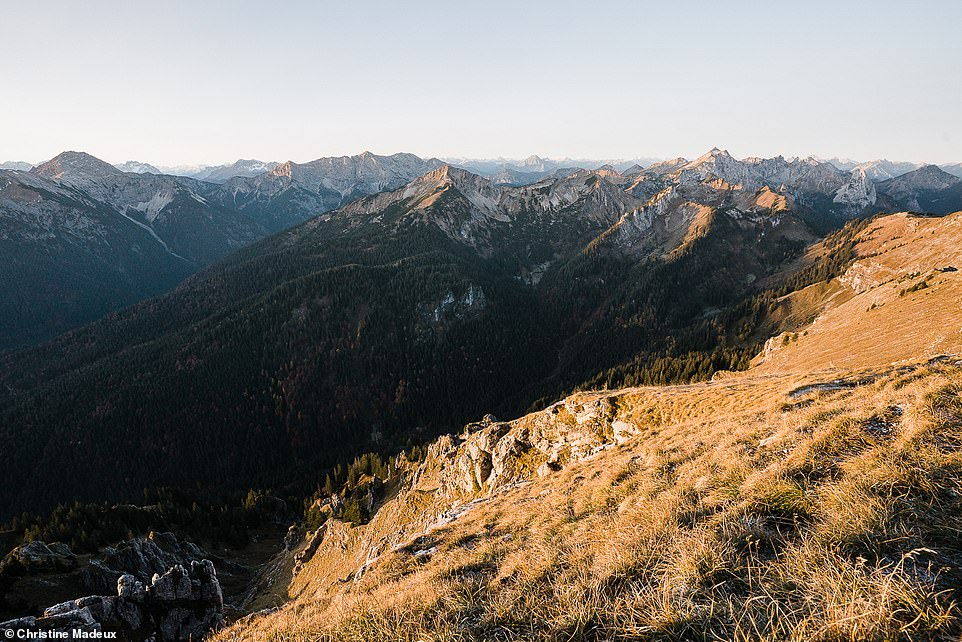 To take her stunning images, Christine often hikes with Scott very early in the morning or late into the night. This beautiful shot was taken at sunrise and shows the view into Austria from the 6,321ft (1,924m) high Grosse Klammspitze mountain, which lies in the Ammergau Alps