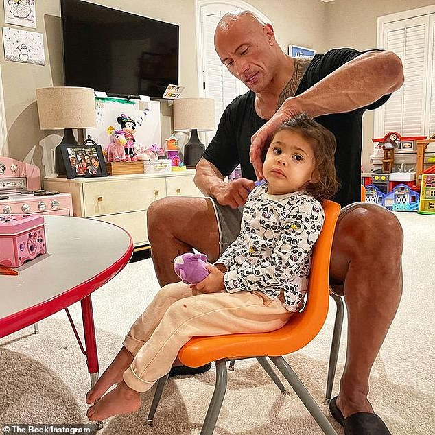 Home life: Dwayne shared this cute photo of him working out some tangles in Tiana's hair