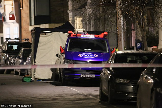 Forensic teams were seen erecting a tent following the fight between six men near Parsons Green Tube station