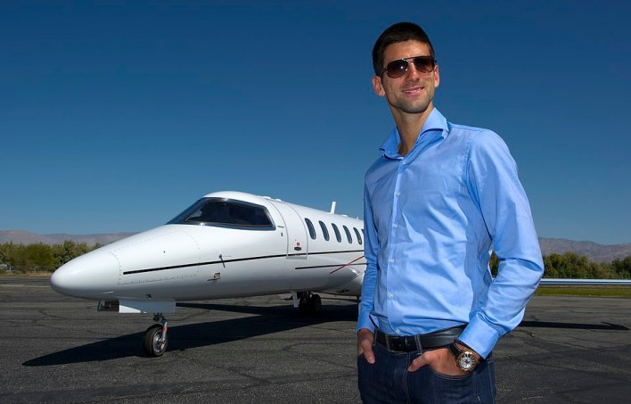 Tennis star Novak Djokovic poses with the Bombardier Learjet 45 XR in Bermuda in 2012