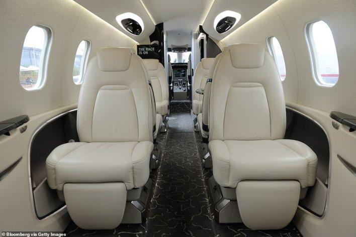 Passenger seats are seen inside a scale model of a Bombardier Learjet 85 in 2013
