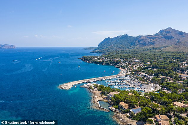 Tui is offering a week's self-catering at the TUI Blue Alcudia Pins hotel in Majorca in July from £638. Pictured is the bay of Pollensa on Majorca's north coast