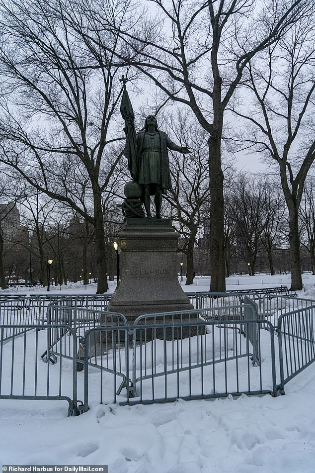 Police vehicles and barricades were still visible around Columbus statues, including this one in Central Park