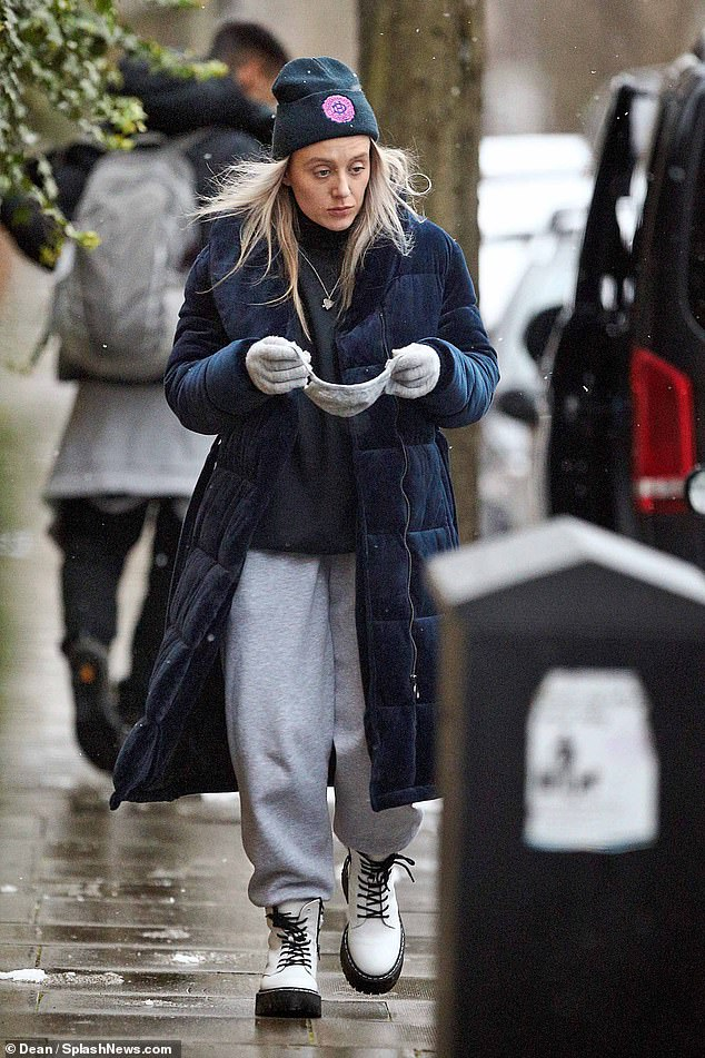 Ms Brown, who was insulated in a blue quilted coat and white chunk- soled boots by US designer Steve Madden, plays for South-West London's FBB Warriors and supports non-league side Dulwich Hamlet, whose woolly hat she wore for her stroll with her boyfriend