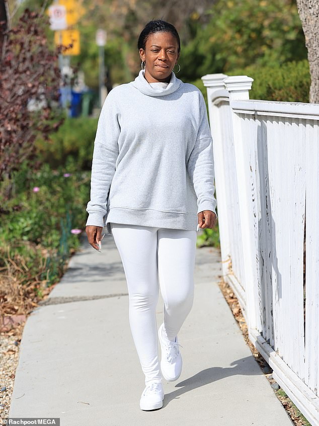 From glue to new 'do: Tessica flaunted her new look as she strolled in a comfortable heather grey turtleneck with white pants and sneakers
