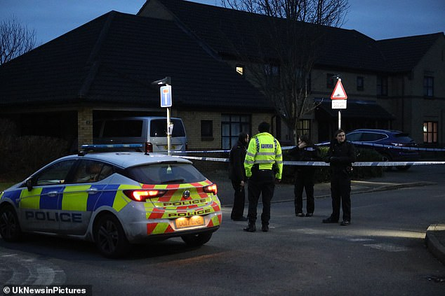 Police remain at the scene of a murder in Managua Close, Caversham, this morning after a 24-year-old man was stabbed to death