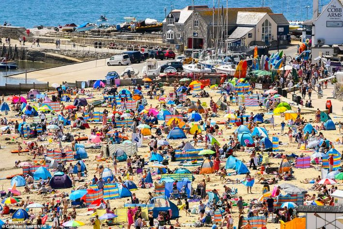 Ministers are also said to be considering plans to allow for families of a single household to travel across the UK for an Easter holiday in self-catered accommodation (holidaymakers at Lyme Regis, Dorset, pictured previously)