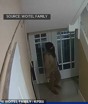 Video from January 8 shows Woitel entering his building at 8.38pm, carrying a bottle on wine in his hand