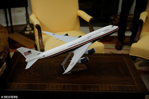 JUST PASSING THROUGH: A model of the new Air Force One is seen in the Oval Office of the White House in Washington, U.S., June 25, 2019