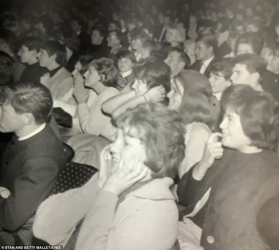 "The crowd is pictured during The Beatles' performance at the ABC. Gary Brady, who went to see the Beatles in 1963, told Exeter Memories: ""In 1963 I went to the Savoy Cinema to see the The Beatles live on stage - jelly babies were everywhere. This was at the beginning of their fabulous career, you couldn't read a paper, magazine or turn on the television without the Beatles being mentioned'"