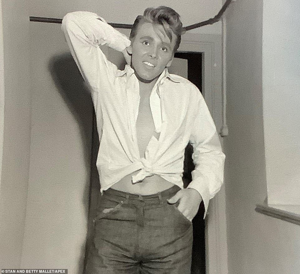 Billy Fury is pictured at some point during the early 1960s. The Liverpool-born singer's real name was Ronald Wycherley and he worked as a docker and on a tug boat before entering and winning a talent competition. By 1958 he had started composing his own songs. His early provocative stage routine was compared to Elvis Presley and he was asked to tone it down