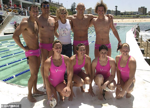 Miller is Australian swimming royalty. In this 2003 photograph, he is pictured back row with Michael Klim and model Sarah Murdoch. Front row includes legendary Olympians Leisel Jones and Petria Thomas (on right)