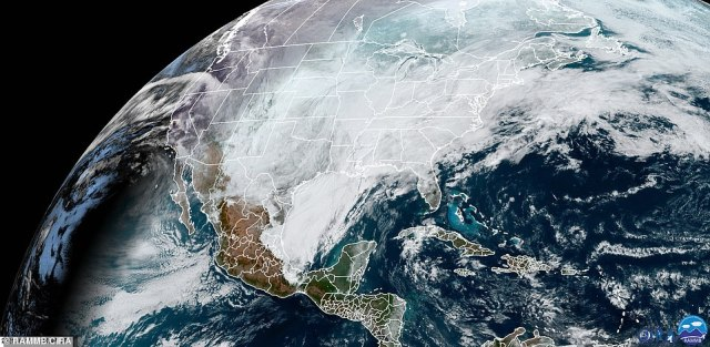 This satellite image shows the storm moving over parts of the southern US and Midwest on Monday morning