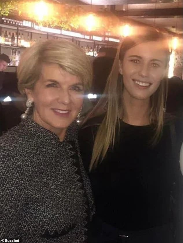 Ms Higgins is pictured with the former deputy leader of the Liberal Party,  Julie Bishop (left)