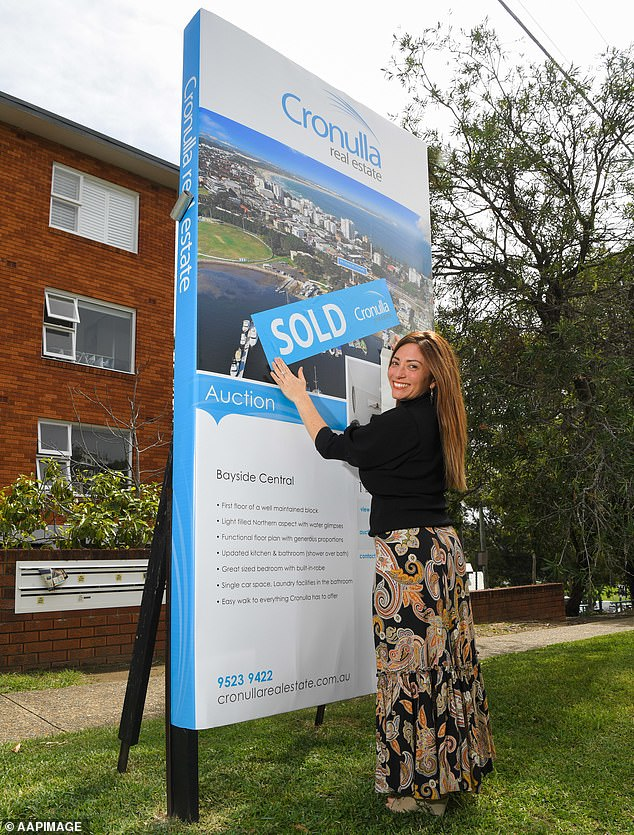 Estate agent Adrianna May at a newly sold property in Cronulla, Sydney.Commonwealth Bank's head of economics Gareth Aird predicted house prices will rise by 9 per cent in 2021 and 7 per cent in 2022 in an economics issues paper published this week