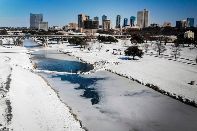 TEXAS:The Trinity River in Fort Worth is mostly frozen after a snow storm Monday that saw millions lose power