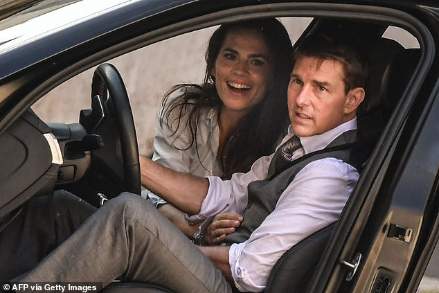 A wrap: Mission: Impossible-7 was hit by a series of delays to filming amid the pandemic (Tom Cruise is seen filming with co-starHayley Atwell in Rome in October)