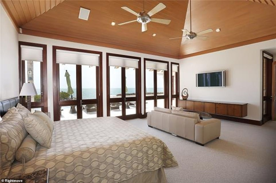 Peace and quiet: The waterfront property has six bedrooms, with views acrossof Biscayne bay and Smugglers Cove
