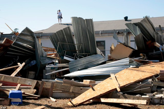 A property owner videos the damage to a home from severe weather in Brunswick County, N.C. near the town of Sunset Beach