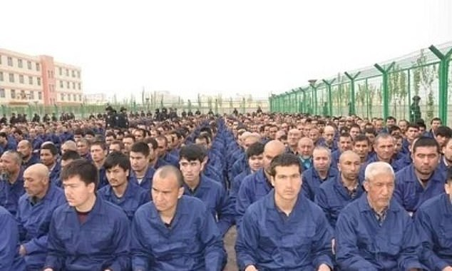 Britain challenging China over its human rights record was supported by 40 percent of respondents, with Beijing facing international criticism of its political oppression of Hong Kong and the forced sterilisation of Uighurs in the country's north-west Xinjiang province. Pictured: A photo allegedly showing detainees in a Xinjiang Re-education Camp