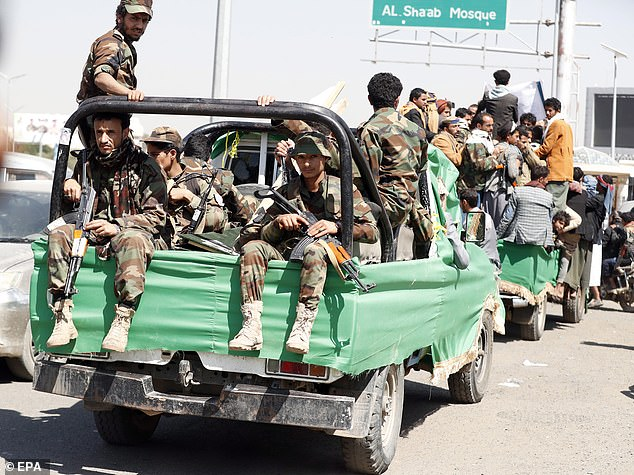 He is expected to warn allowing Covid-19 to spread in areas without vaccination campaigns will increase the risk of new variants taking hold. Pictured:Houthi fighters ride a truck in Sana'a, Yemen, on Tuesday