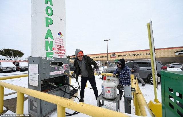 People wait to fill propane tanks outside of Dallas on Tuesday