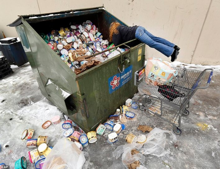 Southwest Arlington, Texas: After seeing a posting on Facebook, LaDonna (no last name given) drove from Johnson County, Texas to collect some of the dumpsters-full of ice cream thrown out at a Southwest Arlington, Texas, Kroger store, Wednesday, Feb. 17, 2021, in Arlington TX. LaDonna said she's collecting the frozen goods for her neighbors. Rolling power outages this week have forced businesses to clear merchandise that needs refrigeration