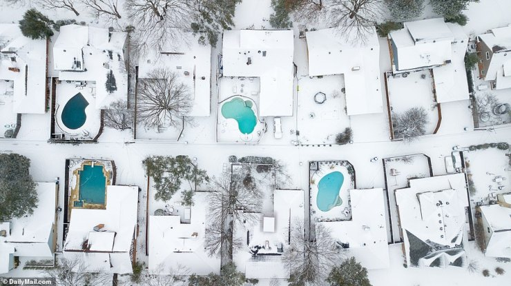 Dallas, Texas: Houses covered with snow on Wednesday afternoon as millions throughout the state were still without power