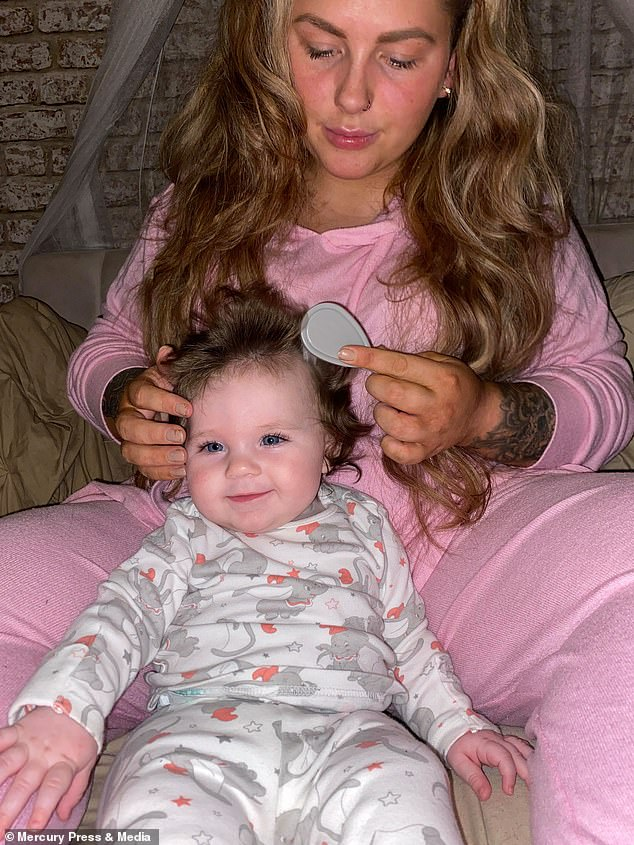 Combing the hair with mum. Jennifer's own hair is often styled into a bun now because she prefers to look afterArabèlla's
