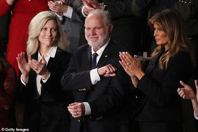 The day after revealing he had cancer, Limbaugh was invited by President Trump to attend his State of the Union where he was awarded the Presidential Medal of Freedom. He is pictured alongside his wife Kathryn and First Lady Melania Trump as the speech
