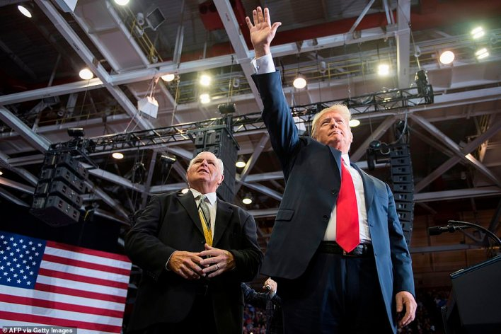 President Donald Trump (right) appeared with Rush Limbaugh (left) at a Make America Great Again rally in November 2018. Trump paid his respects to Limbaugh during a series of phone interviews Wednesday with Fox News Channel, Newsmax and One America