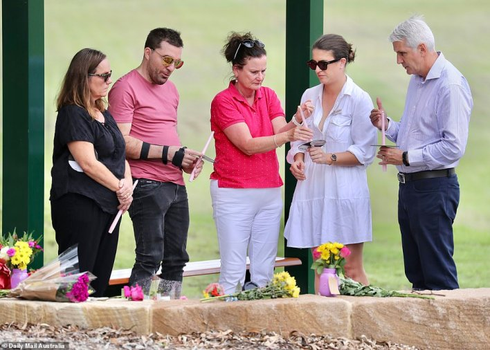Lloyd and Sue Clarke were among many mourners to light candles and lay down flowers in their daughter's and grandchildren's memory at a nearby park in Brisbane's east, where a section has been named 'Hannah's Place.'
