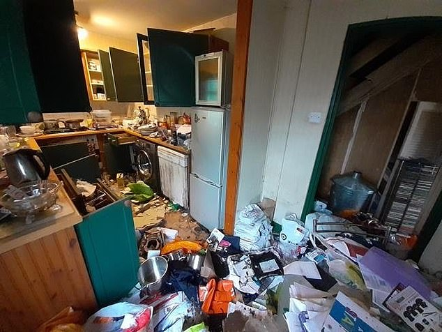 In the kitchen, there are still utilities like a washing machine and fridge - but they're surrounded by dirty plates and old rubbish left behind for months
