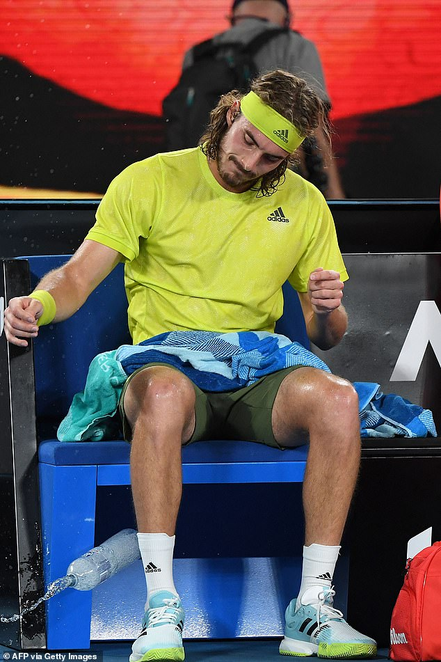 Greece's Stefanos Tsitsipas (pictured above) throws the water bottle on the court between games in the second set against Russia's Daniil Medvedev on Friday