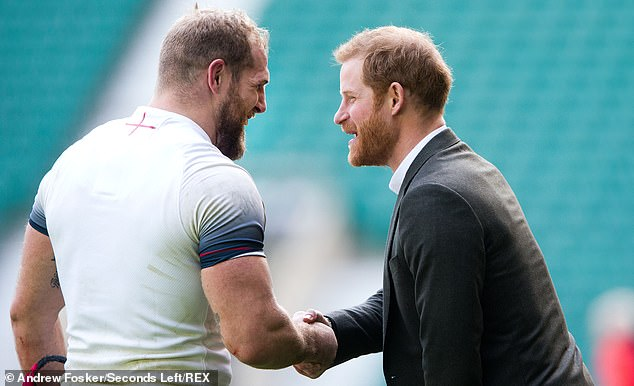 Pictured: Prince Harry shakes hands with James Haskell during England open training in 2018