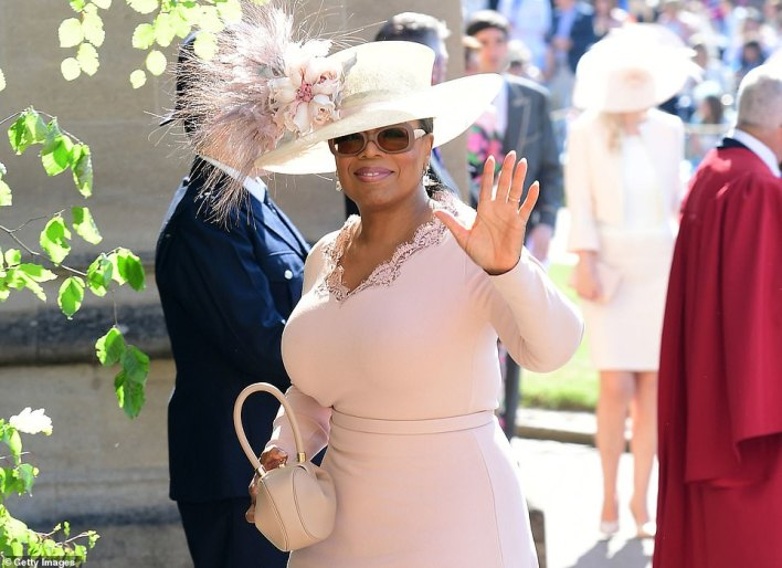 CBS announced the interview by Oprah Winfrey, pictured at Harry and Meghan's Windsor Castle wedding in May 2018