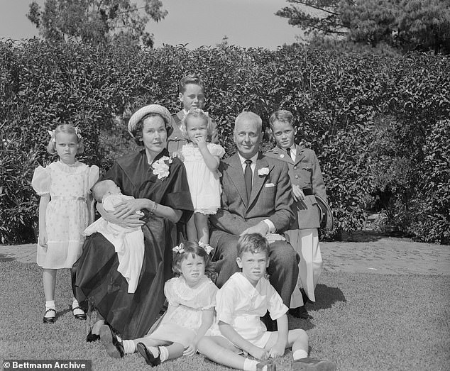 Mia had a difficult upbringing, contracting polio at age nine and being in isolation - before the plane crash death of one brother and suicide of another. The family are pictured together. Mia (then Maria) is seen standing on the left