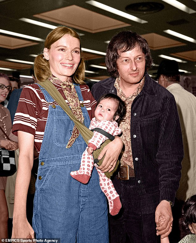 Mia is pictured with adopted Vietnamese daughter Lark at Heathrow Airport with her husband Andre Previn before leaving for Boston