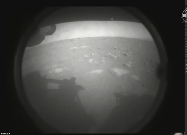 Perseverance beamed back its first image of the crater moments after NASA established radio contact with the rover, leading to raucous applause and joyous scenes at NASA's Californian mission control. The image was snapped while cameras on the rover were still covered with lenses