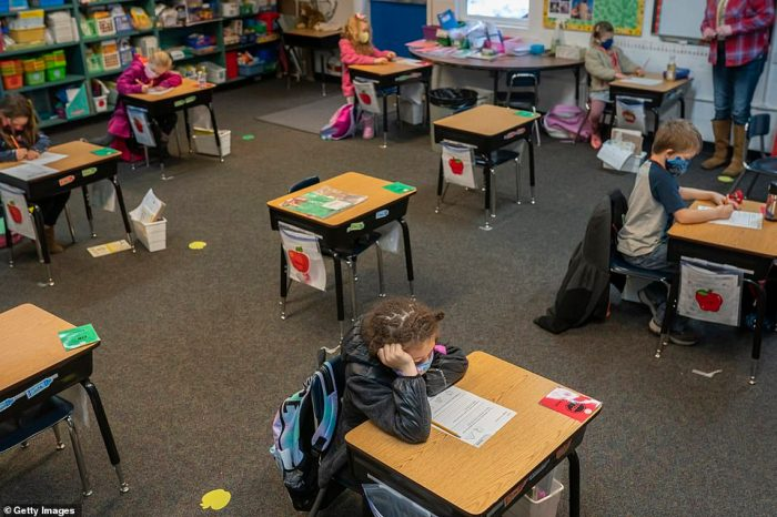First grade students sit at social distanced desks at the Green Mountain School on February 18 in Woodland, Washington