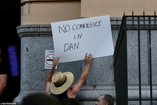 A protester holds a sign reading 'no confidence in Dan' following Melbourne's five-day snap lockdown to contain an outbreak