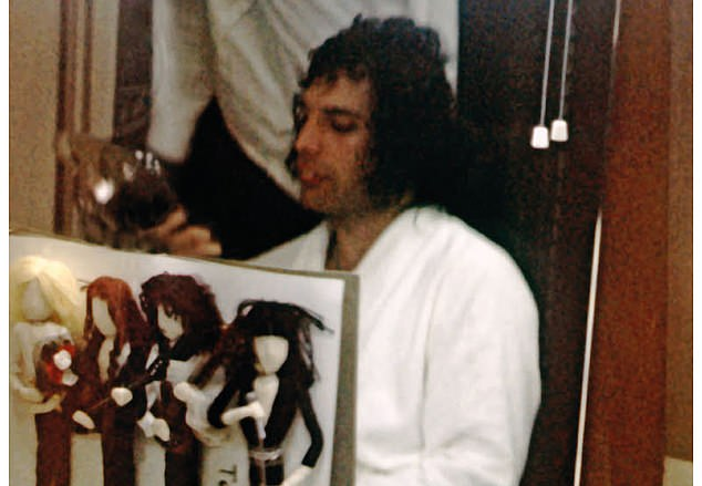 Freddie backstage at the Budokan, Tokyo, 1975. Brian said: 'A gift from the Japanese - lovingly crafted dolls of the four of us'