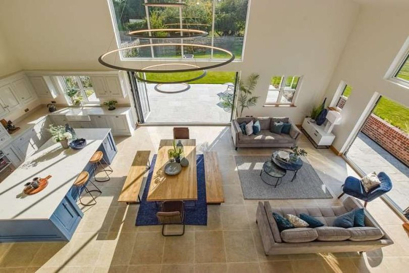 Spread out: The entire downstairs living space is open plan, with the dining and kitchen areas leading onto the vast patio and garden area