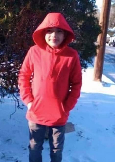 Cristian Pavó, an 11-year-old boy who died in his unheated Texas home. The snow behind him was the first time he had seen snow in his life. He died the next day