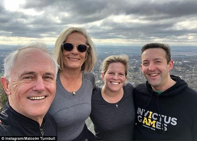 Daisy Turnbull (second from right) appears to be on the dating app Hinge after splitting from her husband James Brown (far right). She is pictured with her parents Malcolm and Lucy Turnbull