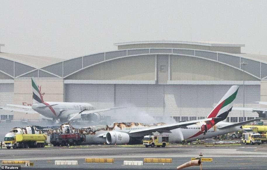The image above shows Emirates Flight 521 after it crashed while attempting to abort a landing in Dubai after flying in from India in August 2016