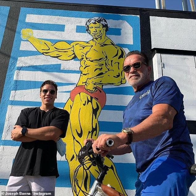 Twins:Last month, Arnold's lookalike son Joseph posted an Instagram snap of himself and his father standing in front of a mural showing Arnie in his bodybuilding days as the Austrian Oak